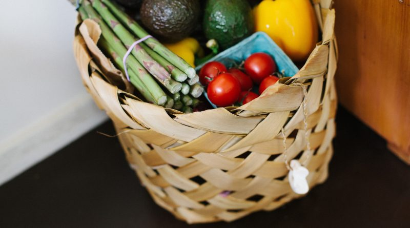 Image is of food hamper with various vegetables such as tomatoes, capsicum and asparagus.