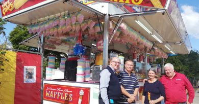 Cr Strunk with community members at the Dagwood Dogs van in Doolandella