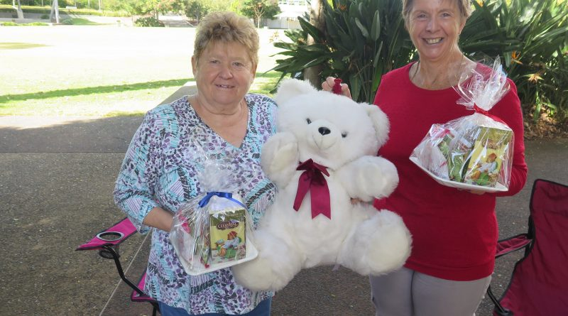 National Seniors Forest Lake members hold teddies and their prizes.