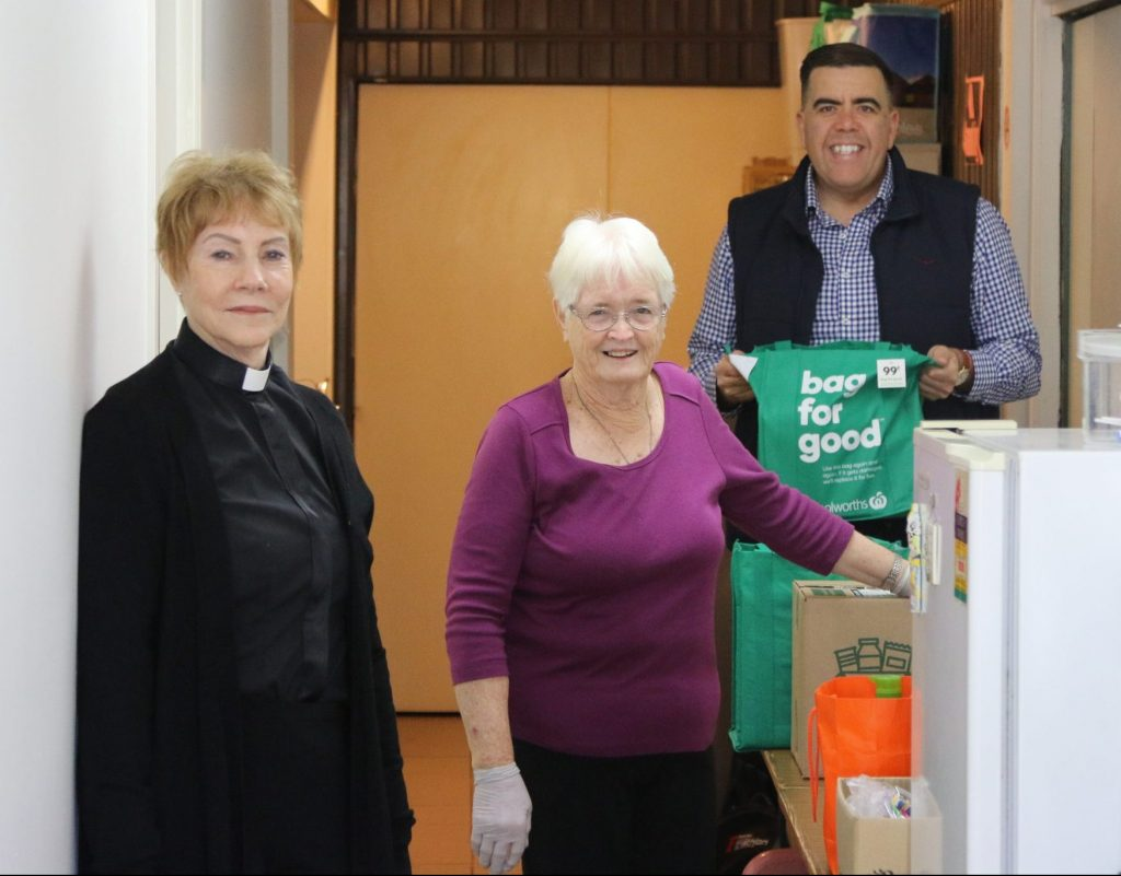 Milton Dick MP with volunteers in the food parcel and relief program at a local church.
