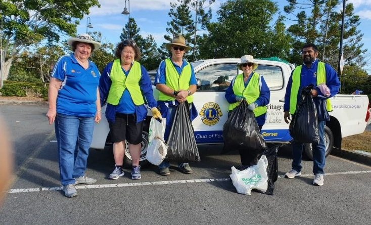 Members of the Forest Lake Lions standing near a car with rubbish in bags collected for the Keep Queensland Beautiful Day.
