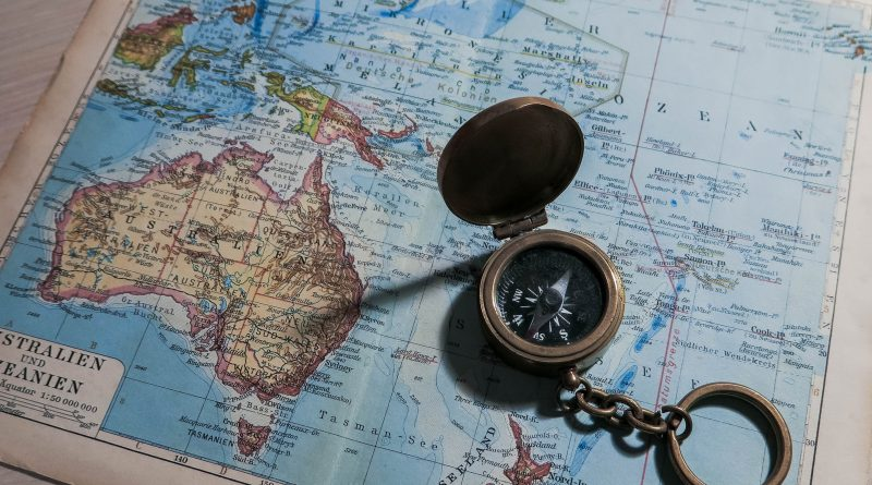 Map of Australia and an old fashioned compass.